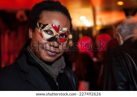 NEW YORK, NY - OCTOBER 31: Guests in mascarade costumes posing at The Fashion Party during Halloween event at the West Village Crema Restaurant on October 31, 2014 in New York City. - stock photo