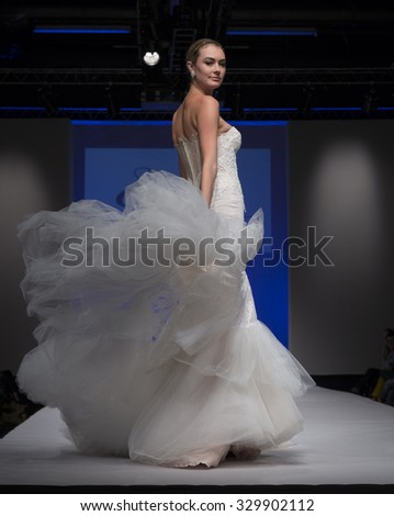 New York, NY - October 11, 2015: Model walks runway for Bridal Couture from Israel by Ester during New York bridal week at Pier 94