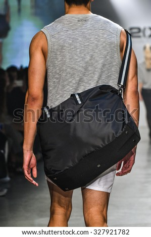 NEW YORK, NY - OCTOBER 14: Model walks the runway during 2(X)IST Men's Spring/Summer 2016 Runway Show at Skyline Modern on October 14, 2015 in NYC