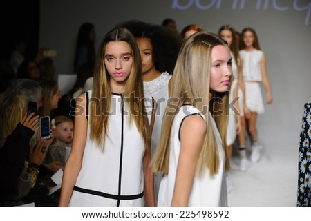 NEW YORK, NY - OCTOBER 19: Models walk the runway finale during the Bonnie Young preview at petitePARADE Kids Fashion Week at Bathhouse Studios on October 19, 2014 in New York City.