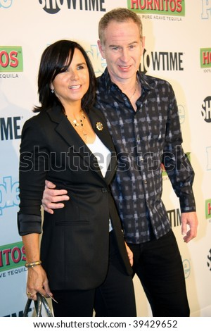 """NEW YORK, NY - OCTOBER 21:Patty Smyth (L) and John McEnroe (R) attend the Bon Jovi film """"When we were beautiful"""" premier on October 21, 2009 in New York City. - stock photo"""