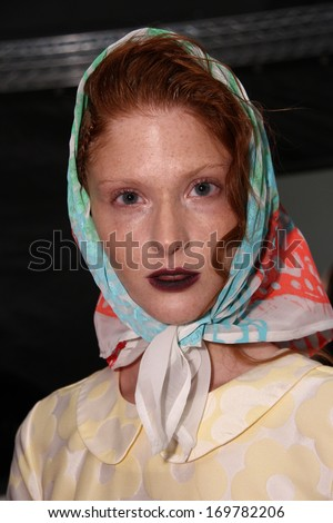 NEW YORK, NY - SEPTEMBER 04: A model is prepped backstage at the Ivana Helsinki fashion show during Mercedes-Benz Fashion Week Spring 2014 at Pier 59 on September 4, 2013 in New York City.  - stock photo