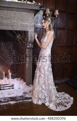 NEW YORK, NY - SEPTEMBER 19: A model posing during the Claire Pettibone Four Seasons Collection Showcase at The Academy Mansion on September 19, 2016 in New York City.