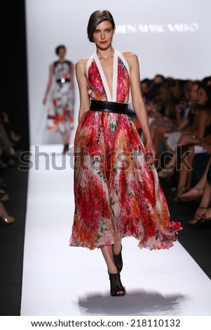 NEW YORK, NY - SEPTEMBER 05: A model walks the runway at Carmen Marc Valvo during Mercedes-Benz Fashion Week Spring 2015 on September 5, 2014 in New York City.  - stock photo