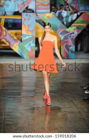 NEW YORK, NY - SEPTEMBER 08: A model walks the runway at DKNY Women's Spring 2014 fashion show during Mercedes-Benz Fashion Week Spring 2014 on September 8, 2013 in New York City.