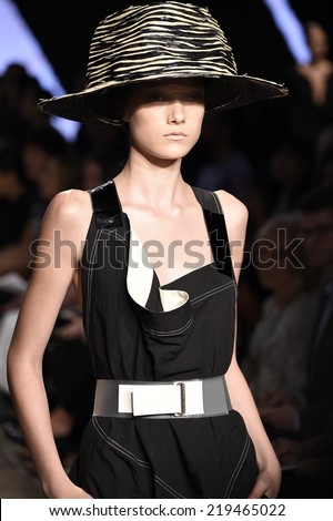 NEW YORK, NY - SEPTEMBER 08: A model walks the runway at Donna Karan New York during Mercedes-Benz Fashion Week Spring 2015 on September 8, 2014 in New York City. - stock photo