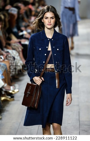 NEW YORK, NY - SEPTEMBER 10: A model walks the runway at Michael Kors during Mercedes-Benz Fashion Week Spring 2015 at Spring Studios on September 10, 2014 in New York City. - stock photo