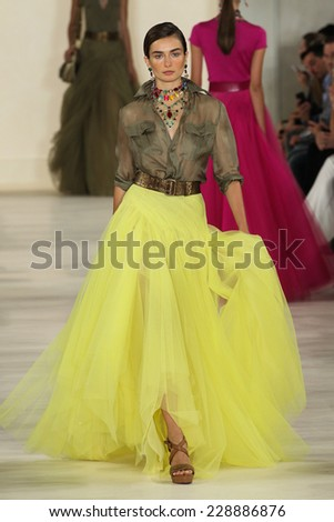 NEW YORK, NY - SEPTEMBER 11: A model walks the runway at Ralph Lauren during Mercedes-Benz Fashion Week Spring 2015 at Skylight Clarkson Sq on September 11, 2014 in New York City. - stock photo