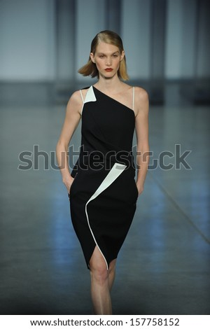 NEW YORK, NY - SEPTEMBER 06: A model walks the runway at the Helmut Lang Spring 2014 fashion show during Mercedes-Benz Fashion Week on September 6, 2013 in New York City. - stock photo