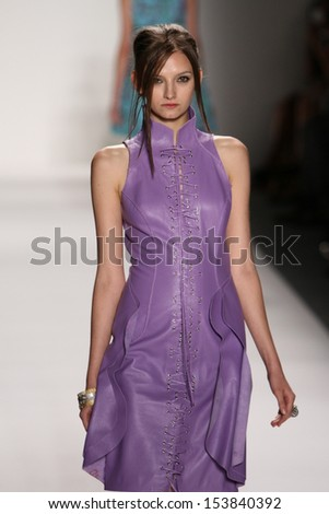NEW YORK, NY - SEPTEMBER 07: A model walks the runway at the Katya Leonovich fashion show during Mercedes-Benz Fashion Week Spring 2014 at Lincoln Center on September 7, 2013 in New York City.