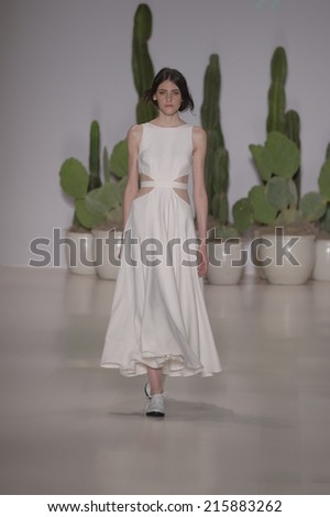 NEW YORK, NY - SEPTEMBER 06: A model walks the runway at the Mara Hoffman Spring-Summer 2015 Collection during Mercedes-Benz Fashion Week Spring 2015 on September 6, 2014 in New York City. - stock photo