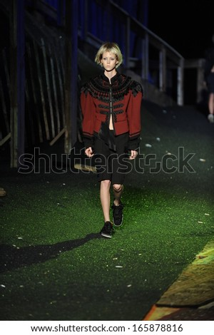 NEW YORK, NY - SEPTEMBER 12: A model walks the runway at the Marc Jacobs fashion show during Spring 2014 Mercedes-Benz Fashion Week on September 12, 2013 in New York City.