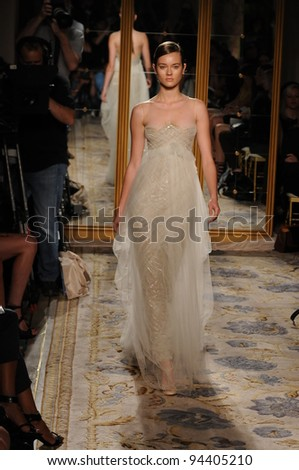 NEW YORK, NY - SEPTEMBER 13: A model walks the runway at the Marchesa Spring 2012 fashion show during Mercedes-Benz Fashion Week at The Plaza Hotel on September 13, 2011 in NYC. - stock photo