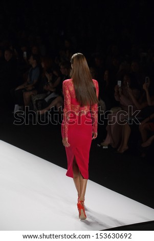 NEW YORK, NY - SEPTEMBER 7: A model walks the runway at the Monique L'Huillier Spring Summer 2014 fashion show during Mercedes-Benz Fashion Week on September 7, 2013 in New York City, USA. - stock photo