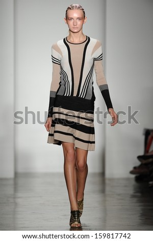 NEW YORK, NY - SEPTEMBER 09: A model walks the runway at the Ohne Titel show during Spring 2014 Mercedes-Benz Fashion Week at Milk Studios on September 9, 2013 in New York City.