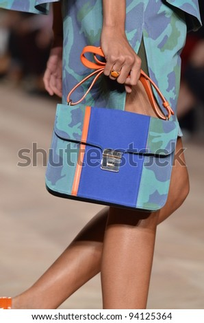 NEW YORK, NY - SEPTEMBER 11: A model walks the runway at the Timo Weiland Spring 2012 fashion show during Mercedes-Benz Fashion Week at The Studio at Lincoln Center on September 11, 2011 in New York. - stock photo