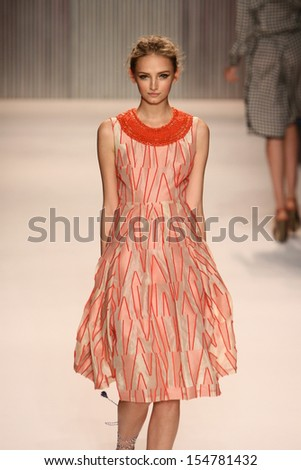 NEW YORK, NY - SEPTEMBER 08: A model walks the Tracy Reese runway during Spring 2014 Mercedes-Benz Fashion Week at The Studio at Lincoln Center on September 8, 2013 in New York City. - stock photo
