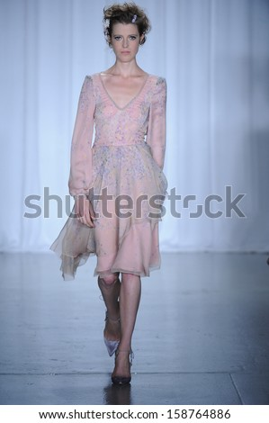 NEW YORK, NY - SEPTEMBER 08: A model walks the Zac Posen runway during Spring 2014 Mercedes-Benz Fashion Week on September 8, 2013 in New York City. - stock photo