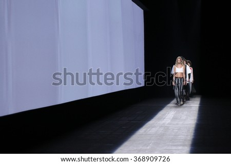 NEW YORK, NY - SEPTEMBER 12: A models walk the runway during the Alexander Wang Spring/Summer 2016 fashion show at Pier 94 on September 12, 2015 in NYC - stock photo