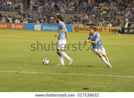 New York, NY - September 16, 2015: Andrea Pirlo (21) of NYC FC controls ball during game between New York City FC and Toronto FC at Yankee Stadium
