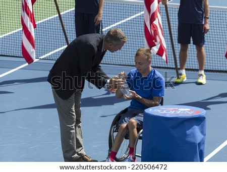 NEW YORK, NY - SEPTEMBER 7, 2014: Andrew Lapthorne of UK with champion trophy of wheelchair Quad Singles final against David Wagner of USA at US Open championship in Flushing Meadows USTA Center - stock photo