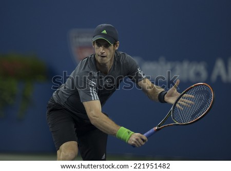 NEW YORK, NY - SEPTEMBER 3, 2014: Andy Murray of United Kingdom returns ball during quarterfinal match against Novak Djokovic of Serbia at US Open championship in Flushing Meadows USTA Tennis Center - stock photo