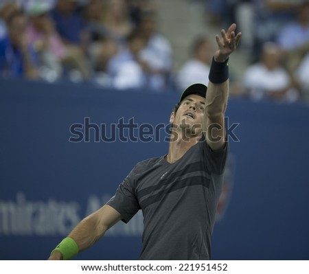 NEW YORK, NY - SEPTEMBER 3, 2014: Andy Murray of United Kingdom serves during quarterfinal match against Novak Djokovic of Serbia at US Open championship in Flushing Meadows USTA Tennis Center - stock photo