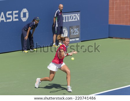 NEW YORK, NY - SEPTEMBER 7, 2014: Anhelina Kalinina of Ukraine returns ball during final girls juniors match against Marie Bouzkova of Czech Republic at US Open championship in Flushing Meadows - stock photo