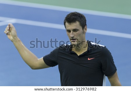 New York, NY - September 3, 2015: Bernard Tomic of Australia reacts during 2nd round match against Lleyton Hewitt of Australia at US Open championship - stock photo