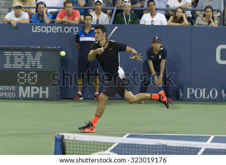 New York, NY - September 3, 2015: Bernard Tomic of Australia returns ball during 2nd round match against Lleyton Hewitt of Australia at US Open championship - stock photo