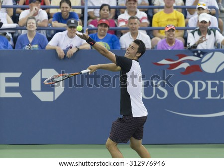 New York, NY - September 3, 2015: Bernard Tomic of Australia serves ball during 2nd round match against Lleyton Hewitt of Australia at US Open championship - stock photo