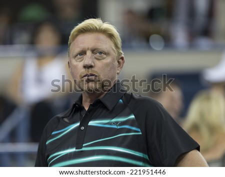 NEW YORK, NY - SEPTEMBER 3, 2014: Boris Becker attend quarterfinal match between Andy Murray of United Kingdom & Novak Djokovic of Serbia at US Open championship in Flushing Meadows USTA Tennis Center - stock photo