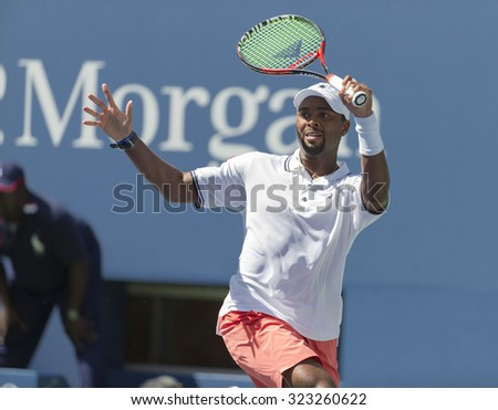 New York, NY - September 7, 2015: Donald Young of USA returns ball during 4th round match against Stan Wawrinka of Switzerland at US Open Championship - stock photo