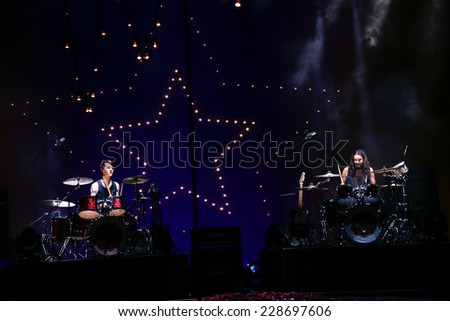 NEW YORK, NY - SEPTEMBER 08: Drummers Tara Ferry (L) and Steve Hash perform at Tommy Hilfiger Women's fashion show during MBFW Spring 2015 at Park Avenue Armory on September 8, 2014 in NYC. - stock photo
