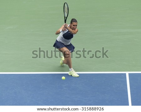New York, NY - September 12, 2015: Flavia Pennetta of Italy returns ball during final match against Roberta Vinci of Italy at US Open Championship - stock photo