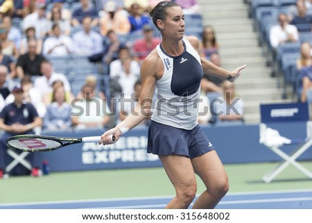New York, NY - September 11, 2015: Flavia Pennetta of Italy returns ball during semifinal match against Simona Halep of Romania at US Open Championship - stock photo