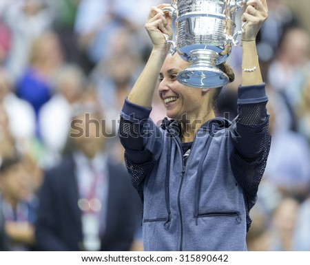 New York, NY - September 12, 2015: Flavia Pennetta of Italy winner of US Open Championship during trophy presentation at Ash Stadium - stock photo