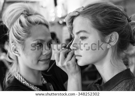 New York, NY - September 12, 2015: Georgie Perkins prepares backstage for the Monique Lhuillier Spring 2016 fashion show during New York Fashion Week at The Arc - Skylight Moynihan Station - stock photo
