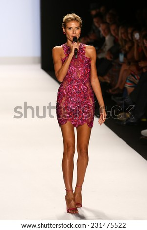 NEW YORK, NY - SEPTEMBER 05: Heidi Klum closes the show at the Project Runway show during Mercedes-Benz Fashion Week Spring 2015  at Lincoln Center on September 5, 2014 in NYC - stock photo