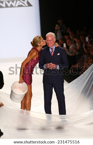 NEW YORK, NY - SEPTEMBER 05: Heidi Klum kiss Tim Gunn after ALS Ice Bucket Challenge at Project Runway during MBFW Spring 2015  on September 5, 2014 in NYC - stock photo