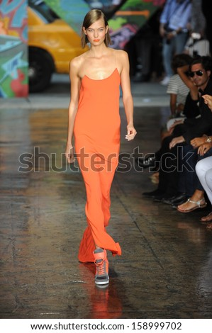 NEW YORK, NY - SEPTEMBER 08: Karlie Kloss walks the runway at DKNY Women's Spring 2014 fashion show during Mercedes-Benz Fashion Week Spring 2014 on September 8, 2013 in New York City.  - stock photo