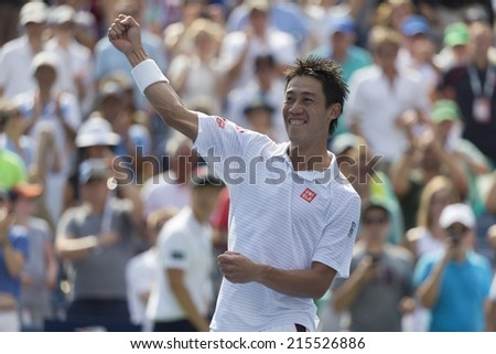 NEW YORK, NY - SEPTEMBER 6, 2014: Kei Nishikori of Japan celebrates victory of semifinal match against Novak Djokovic of Serbia at US Open championship in Flushing Meadows USTA Tennis Center - stock photo