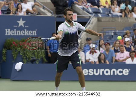 NEW YORK, NY - SEPTEMBER 6, 2014: Marin Cilic of Serbia returns ball during semifinal match against ROger Federer of Switzerland at US Open championship in Flushing Meadows USTA Tennis Center - stock photo