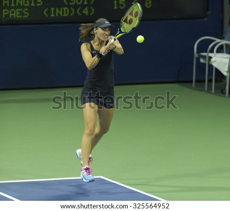 New York, NY - September 2, 2015: Martina Hingis of Switzerland returns ball during 1st round match with Leander Paes of India against Clare Liu & Taylor Harry Fritz of USA at US Open Championship - stock photo