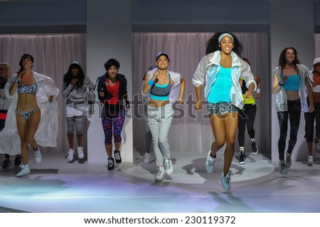 NEW YORK, NY - SEPTEMBER 03: Models perform during the Athleta  Runway show during Mercedes-Benz Fashion Week Spring 2015 at SIR Stage on September 3, 2014 in NYC - stock photo