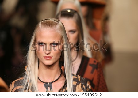 NEW YORK, NY - SEPTEMBER 09: Models walk the runway finale at the Donna Karan New York fashion show during Mercedes-Benz Fashion Week Spring 2014 on September 9, 2013 in New York City. - stock photo