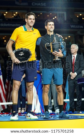 New York, NY - September 9, 2018: Novak Djokovic of Serbia & Juan Martin del Potro of Argentina hold their trophies after men's single final of US Open 2018 against  at USTA National Tennis Center