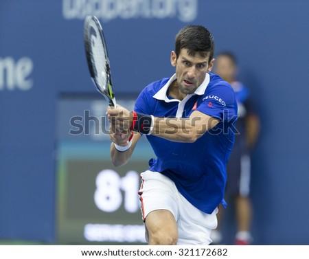 New York, NY - September 11, 2015: Novak Djokovic of Serbia returns ball during semifinal against Marin Cilic of Croatia at US Open Championship on Ash stadium - stock photo