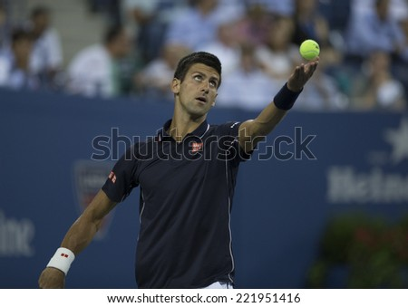 NEW YORK, NY - SEPTEMBER 3, 2014: Novak Djokovic of Serbia serves during quarterfinal match against Andy Murray of United Kingdom at US Open championship in Flushing Meadows USTA Tennis Center - stock photo