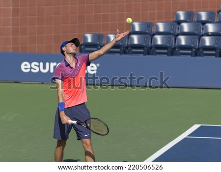 NEW YORK, NY - SEPTEMBER 7, 2014: Quentin Halys of France serves ball during final boys juniors match against Omar Jasika ofAustralia at US Open championship in Flushing Meadows USTA Tennis Center - stock photo